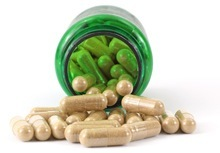 open-green-bottle-filled-with-capsules